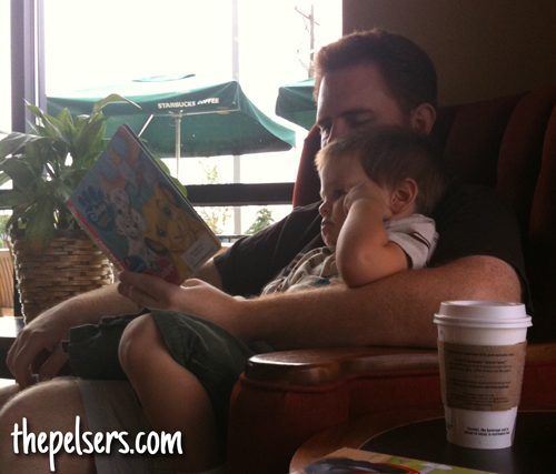 Josh Reading to Jonathan at Starbucks ~ September 2009