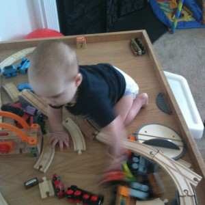 Jacob Climbing on Train Table